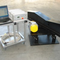 A set up of vibrational equipment type VZ 4 with a sprung table for vibrational treatment of assemblies with small dimensions