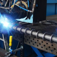 Automated laser process employed for welding rotary parts